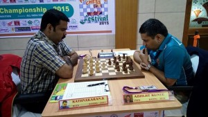 Former British champion GM Abhijit Kunte (right) defeated IM K rathnakaran of Railways