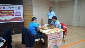 Karthikeyan (right) drew his game against GM Abhijit Kunte to keep in the front