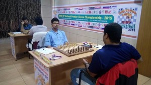 Praneeth facing the camera missed his GM norm by losing to IM Rathnakaran