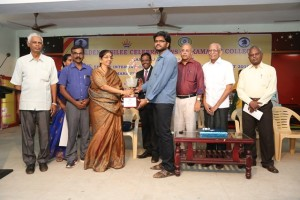 IM Shyaam Nikhil receiving ---- From left to right: IA R. Anantharam CHief arbiter, Mrs. T Karpagavalii organising secretary, M. Ephrame Joint Secretary TNSCA, Dr.D. Nagarajan Principal, Kamaraj College, IM P. Shyaam Nikhil, Paramaguru, Propreitor Agsar Chemicals, Dr. Vasikaran, President Teekay Chess Center and Dr. Sakthivel, Director, Kamaraj College