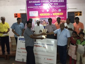 Ram S Krishnan receiving the second prize from Sri. VR Muthu